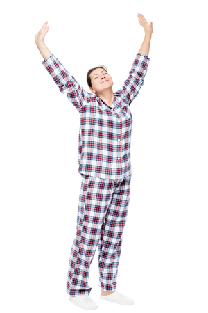 Stretched girl in pajamas on a white background in full length Stock Photo