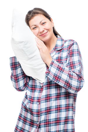 Vertical portrait of a woman in pajamas with a soft pillow isolated Stock Photo