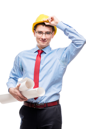 corrects: Architect with drawings corrects his hand with a yellow helmet on his head isolated Stock Photo