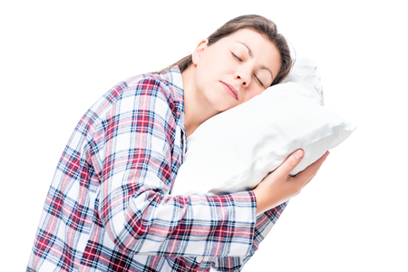 Portrait of a sleeping woman on a pillow on a white background