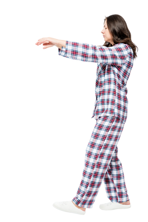 somnambulism: Young girl suffering from sleepwalking in a dream, portrait in full length on a white background Stock Photo