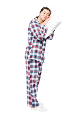 Tired woman asleep standing, portrait in full length on a white background Stock Photo