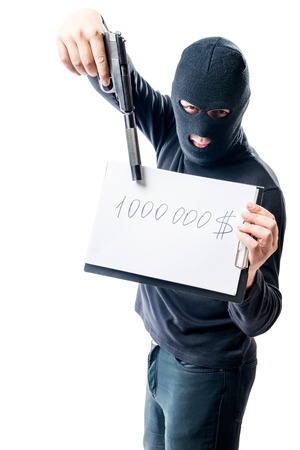 Bandit in black clothes showing weapons, in the amount of ransom for hostages
