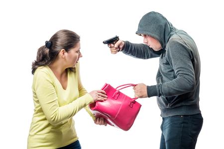 Thief threatens a victim with a gun, steals a bag