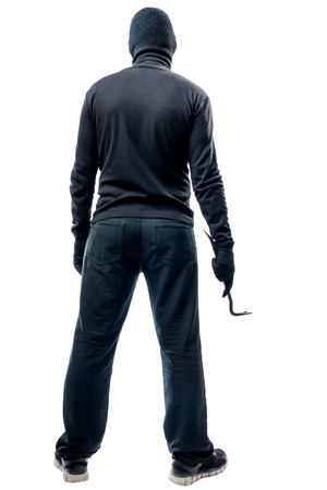 Full length criminal with a crowbar on a white background Stock Photo