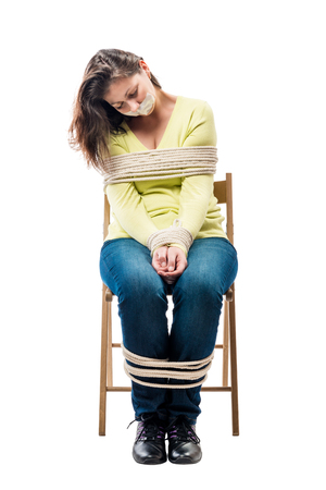 Tired sleeping on a stool hostage bound by ropes on a white background Stock Photo