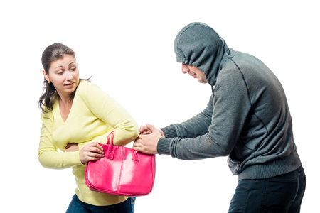 Girl with a pink bag became a victim of a robber, a portrait on a white background