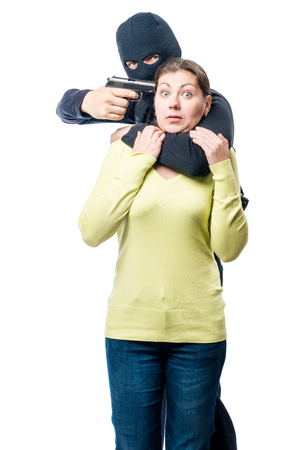 A dangerous criminal with arms and a young woman on a white background Stock Photo