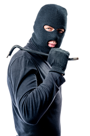 Robber with a crowbar in black clothes on a white background