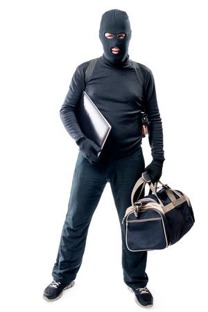 furtive: Robber with a bag and a laptop in full length on a white background