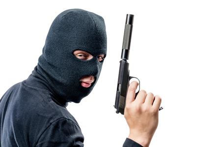 Horizontal portrait of a terrorist with a gun with a silencer on a white background