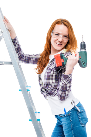sexy young woman with a drill on a white background