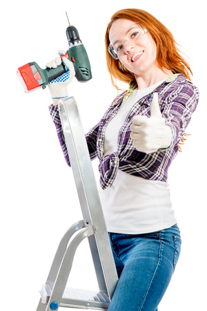 happy young woman with a tool on a white background