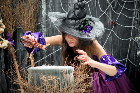 An experienced sorceress poured into a cauldron, a potion from a bottle
