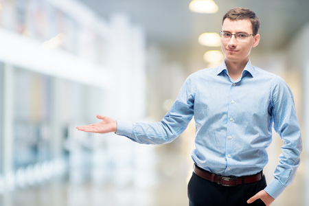 Businessman presenting space to the left in office