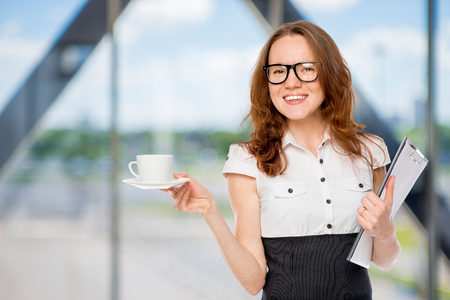 businesswoman with a cup of coffee in the office Stock Photo