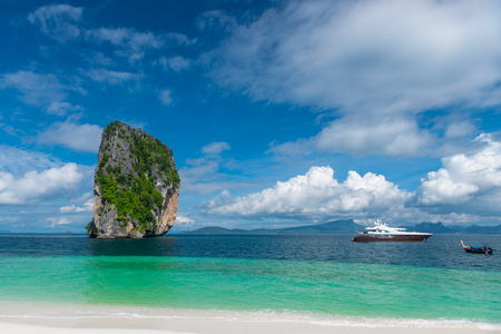 boats, sea, clouds and a beautiful cliff face view from the island of Poda, Thailand