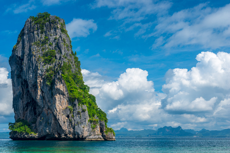 beautiful cumulus clouds, clear sea and high cliff - stunning views Poa Island, Thailand Stock Photo
