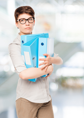woman with blue folder for documents in the office