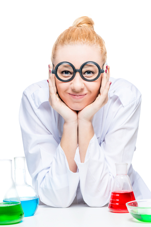 Vertical portrait of blond doctor chemist with test tubes on white background