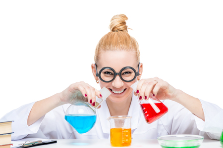 Happy lab assistant mixes fluids in a laboratory, girl in comic glasses Stock Photo