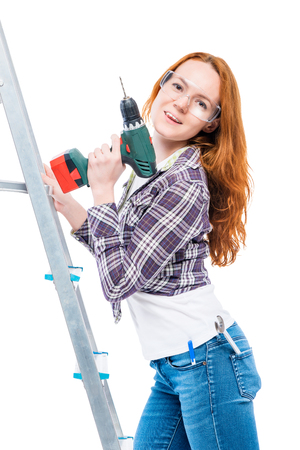 young housewife with tools on white background Stock Photo