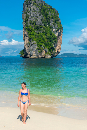girl in bikini on the beach of the island of Poda, Thailand