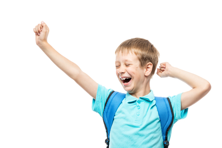 student yawns and stretches in the morning before going to school on a white background Stock Photo