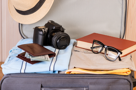 a suitcase with things for a young stylish person, things close-up Stock Photo