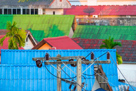 The top view of the roofs of the houses and the high-voltage line Stock Photo