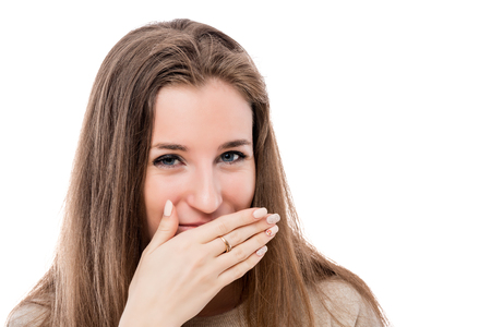portrait of a young girl with a bad smell from her mouth on a white background isolated Stock Photo