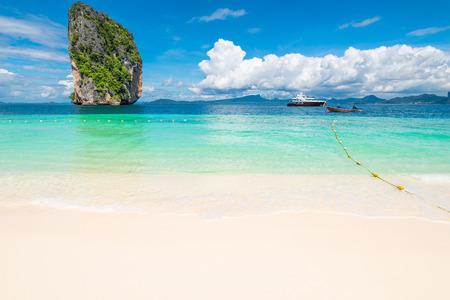 rock, boats and beautiful sky stunning seascape, Poda Island Thailand