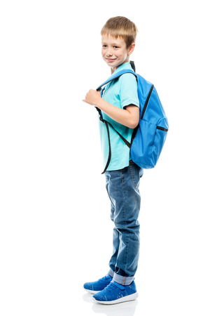 portrait of a schoolboy with a backpack side view on a white background in full length