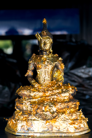small buddha figure in gold leaf close-up