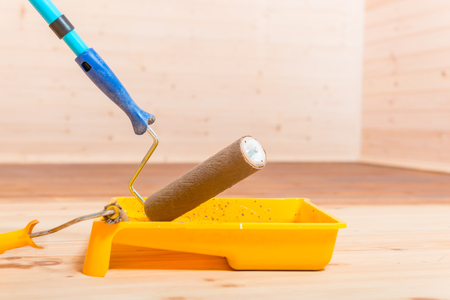 tools for painting houses - roller, paint and tray close-up