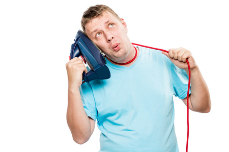 concept of a crazy man strangling himself with a wire from an iron on a white background Stock Photo