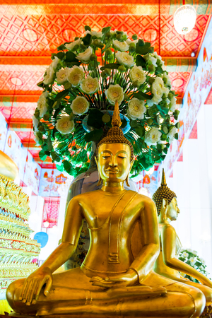 temple of Bangkok - sitting Buddha and beautiful flowers