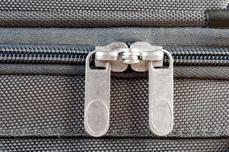 close-up two zipper runner buttoned gray suitcase macro