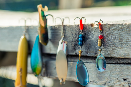 close-up of baubles and hooks for fishing close-up on a wooden pier