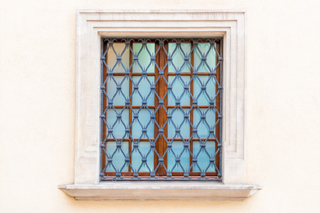 window with a medieval-style grille in the castle