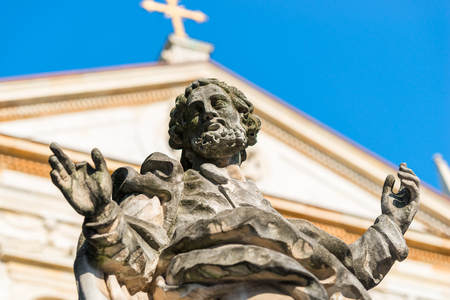 sculpture of the apostle against the background of the Catholic church in Krakow Stock Photo