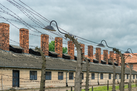 Auschwitz, Poland - August 12, 2017: the territory of a concentration camp close-up of barbed wire, on which high voltage was applied
