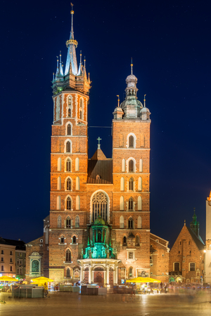 night view of the market square and the church in the center of Krakow