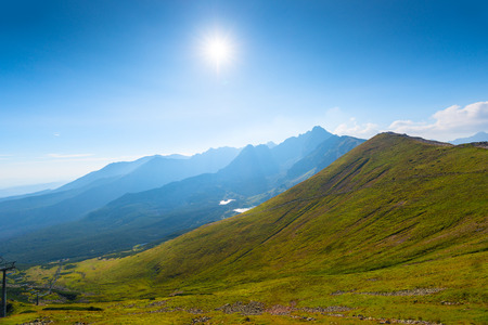 Bright sunshine over high beautiful mountains in Poland Kasprowy Wierch