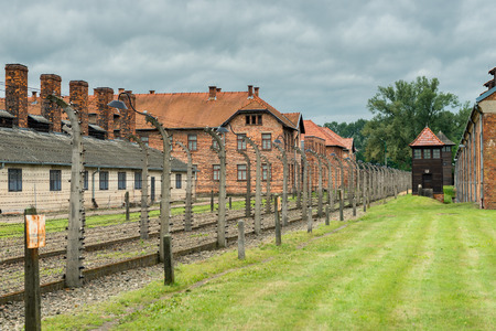 Auschwitz, Poland - August 12, 2017: Auschwitz concentration camp surrounded by barbed wire