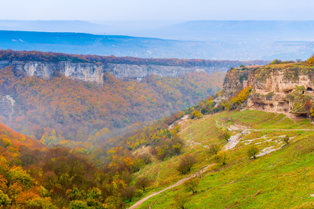 The cave city of Chufut-Kale and the valley on a cloudy autumn day, Crimea, Russia