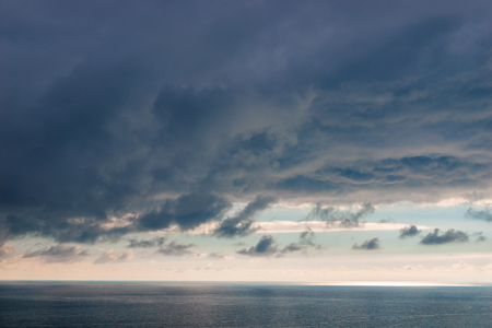 Heavy blue clouds over the sea dramatic seascape