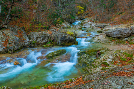 Stunning landscape of a mountain river among large stones in the mountains in autumn Banco de Imagens
