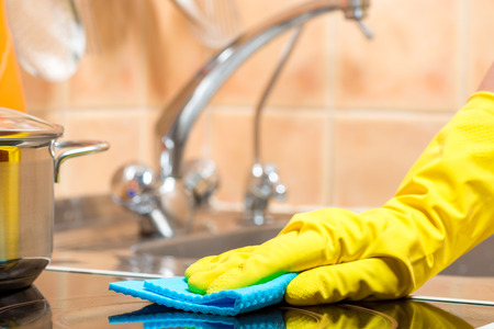 hand with a rag, housewife during cleaning, hand close-up Stock Photo