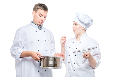 emotions of cooks in relation to foul soup in a pan, a portrait on a white background Foto de archivo